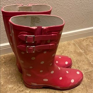 Pink polka dotted rain boots